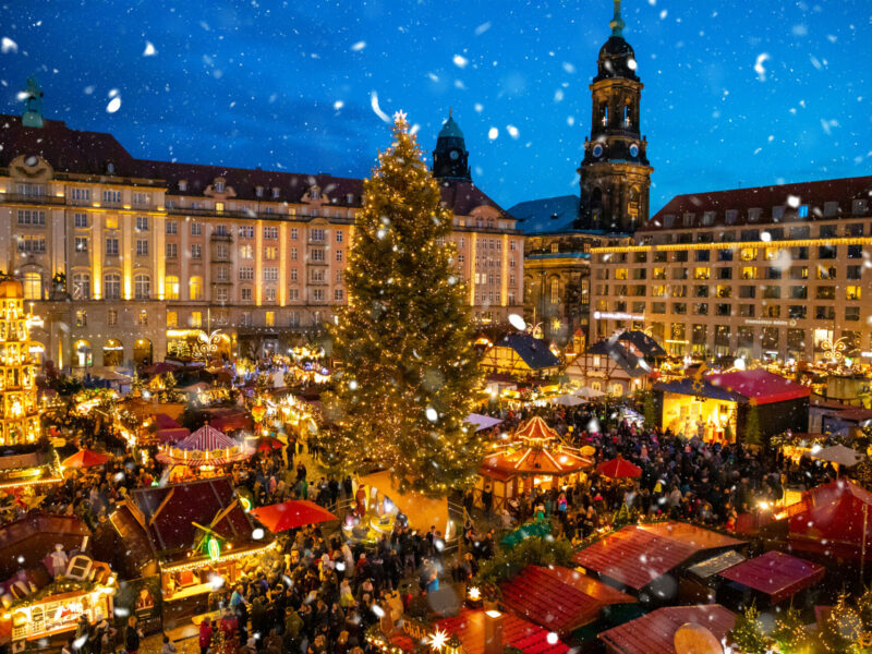 People visit Christmas Market Striezelmarkt in Dresden in Germany